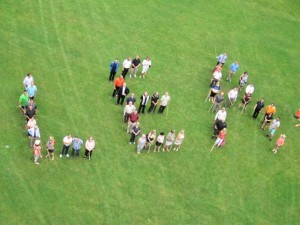 Members of the London Executive Association spell out LEA